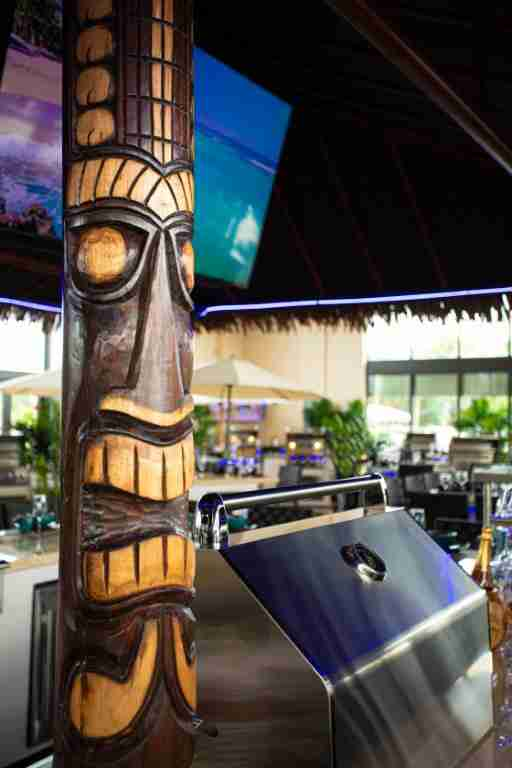 Paradise Grills Frisco Showroom Hand Carved Tiki Poles